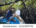 young man during boat trip... | Shutterstock . vector #1312209746