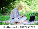 woman with laptop sit grass... | Shutterstock . vector #1312255799