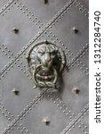 bronz lion head door knob on an ... | Shutterstock . vector #1312284740