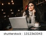 beautiful woman working with... | Shutterstock . vector #1312363343