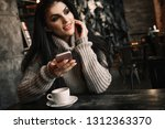 woman using phone and drinking... | Shutterstock . vector #1312363370