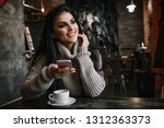 woman using phone and drinking... | Shutterstock . vector #1312363373