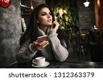 woman using phone and drinking... | Shutterstock . vector #1312363379