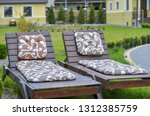 wooden loungers in the garden... | Shutterstock . vector #1312385759