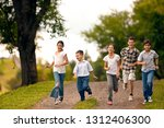 small group of children running ...   Shutterstock . vector #1312406300