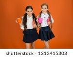 schoolgirl hold book or notepad ... | Shutterstock . vector #1312415303