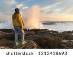 solitary woman standing empty... | Shutterstock . vector #1312418693