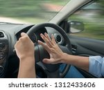 male driver steering a car and... | Shutterstock . vector #1312433606