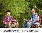 men having a bible study on a...   Shutterstock . vector #1312435253