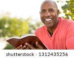african american man holding a...   Shutterstock . vector #1312435256