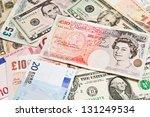 Stock photo  international currencies poland z england pound u s dollar russia ruble switzerland 131249534