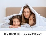 young woman and her daughter... | Shutterstock . vector #1312548239