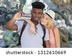 beautiful couple making a...   Shutterstock . vector #1312610669