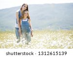woman and child in nature | Shutterstock . vector #1312615139