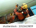 working at height. an abseiler... | Shutterstock . vector #1312615859