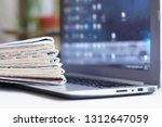 newspapers and laptop.... | Shutterstock . vector #1312647059