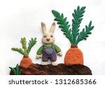 bunny in overalls in the garden ... | Shutterstock . vector #1312685366