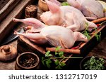 fresh raw quail on a kitchen... | Shutterstock . vector #1312717019