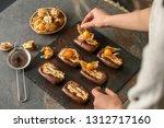 female confectioner decorating...   Shutterstock . vector #1312717160