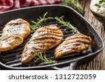 grilled chicken breast in grill ... | Shutterstock . vector #1312722059