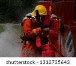 firefighter training fire... | Shutterstock . vector #1312735643