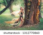 gentle girl with blond hair... | Shutterstock . vector #1312770860