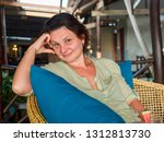 middle aged woman drinking... | Shutterstock . vector #1312813730