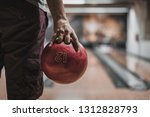 Small photo of A close-up of a hand with bowling ball in a bowling alley. Bowling night