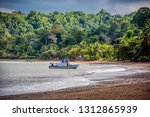 a boat anchored in a bay in osa ... | Shutterstock . vector #1312865939