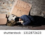 beggar in tattered clothes... | Shutterstock . vector #1312872623