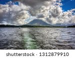 arenal volcano from lake arenal ... | Shutterstock . vector #1312879910
