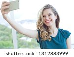 woman with phone | Shutterstock . vector #1312883999