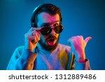 enjoying his favorite music.... | Shutterstock . vector #1312889486