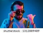 enjoying his favorite music.... | Shutterstock . vector #1312889489