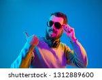 enjoying his favorite music.... | Shutterstock . vector #1312889600