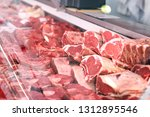 meat displayed for sale in... | Shutterstock . vector #1312895546