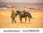 man leads the horse in the...   Shutterstock . vector #1312985099