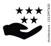 hand holing 5 star rating | Shutterstock .eps vector #1312997630