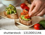 woman preparing tasty... | Shutterstock . vector #1313001146