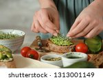 woman preparing tasty... | Shutterstock . vector #1313001149