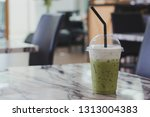 green tea on the table in the... | Shutterstock . vector #1313004383