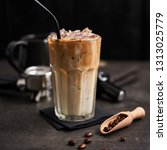 ice coffee with cream in a tall ... | Shutterstock . vector #1313025779