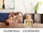 reed diffuser on table in room | Shutterstock . vector #1313036483