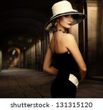 Woman In Black Dress And Big...