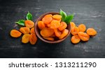 dried apricots in a bowl on a... | Shutterstock . vector #1313211290