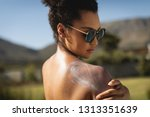 side view of young mixed race... | Shutterstock . vector #1313351639