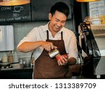 happy asian barista pouring... | Shutterstock . vector #1313389709