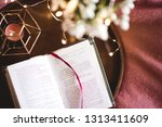 open bok with candle and... | Shutterstock . vector #1313411609