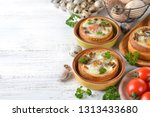 baked egg in bun on white... | Shutterstock . vector #1313433680