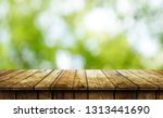 empty wooden table background | Shutterstock . vector #1313441690